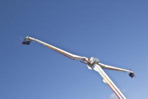 fairground ride against blue sky